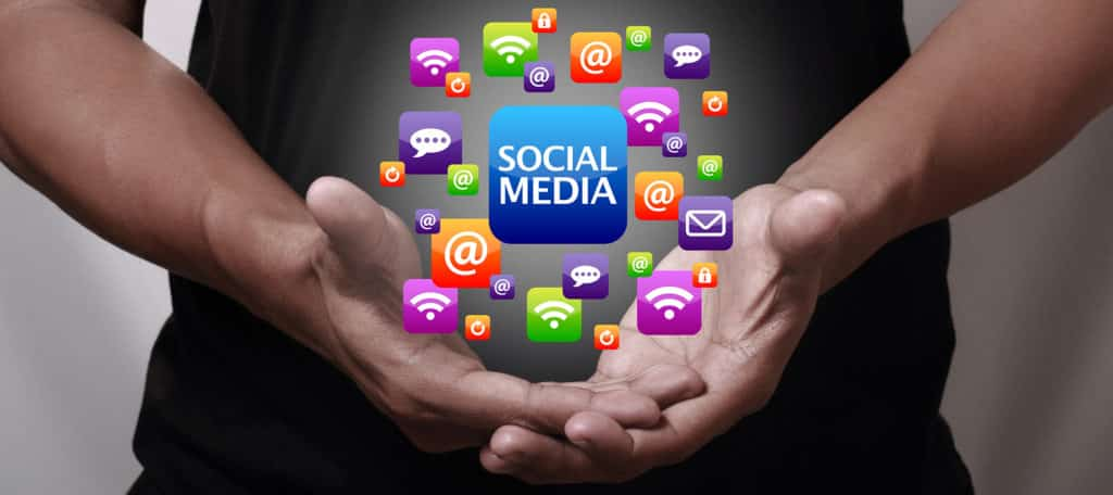 Hand showing social media icons